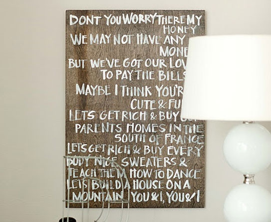 lyrics stenciled over large canvasses and hang each in your bedroom